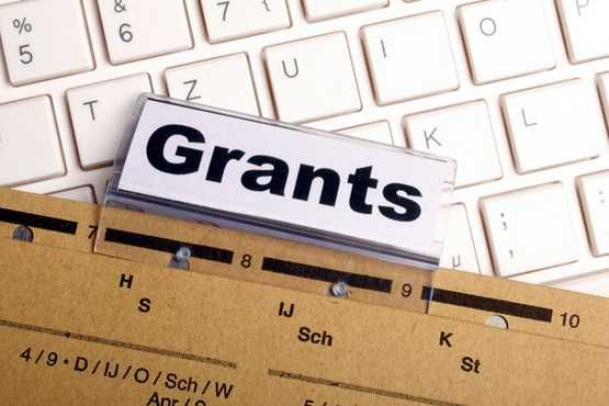 Grants file folder on laptop keyboard