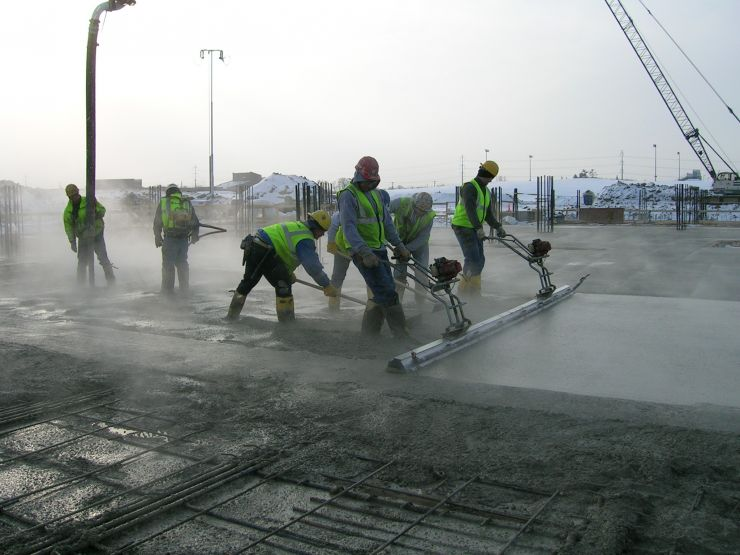 Workers placing concrete